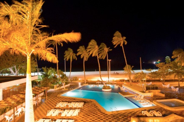 Pool area at night at a West Indies beach resort.